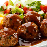 Roasted meatballs and French fries Stock Photos