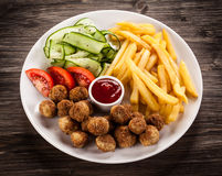 Roasted meatballs and French fries Stock Image