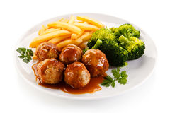 Roasted meatballs and French fries Stock Photo
