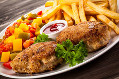 Roasted meatballs and French fries Royalty Free Stock Photo