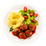 Roasted meatballs, mashed potatoes and vegetables Royalty Free Stock Images