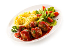 Roasted meatballs, mashed potatoes and vegetables Stock Images
