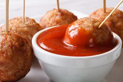 Roasted meatballs on skewers with ketchup closeup Royalty Free Stock Images