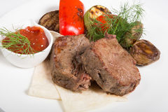 Roasted mignon steak. Served with vegetables and sauce stock photo