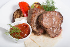 Roasted mignon steak. Served with vegetables and sauce royalty free stock photo