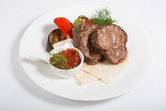 Roasted mignon steak. Served with vegetables and sauce stock images
