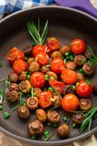 Roasted mushrooms with cherry tomatoes Royalty Free Stock Image