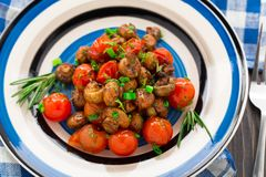 Roasted mushrooms with cherry tomatoes Stock Images