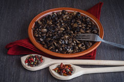 Roasted mushrooms with spices on plate, wooden background Stock Photography
