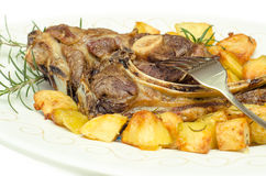 Roasted mutton and potatoes Stock Photography