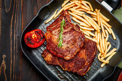 Roasted organic shin of beef meat. On wooden table Stock Images