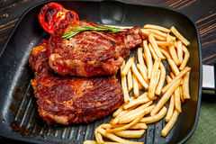 Roasted organic shin of beef meat. On wooden table Royalty Free Stock Image