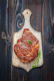 Roasted organic shin of beef meat. On wooden table Royalty Free Stock Photo