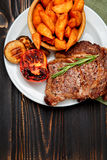 Roasted organic shin of beef meat. On wooden table Royalty Free Stock Photos