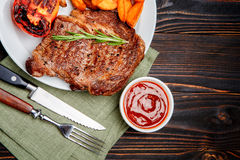Roasted organic shin of beef meat. On wooden table Royalty Free Stock Photography