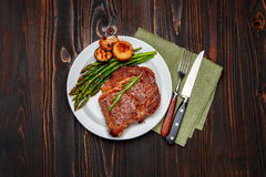 Roasted organic shin of beef meat. On wooden table Royalty Free Stock Images