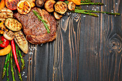 Roasted organic shin of beef meat. On wooden table Stock Photography