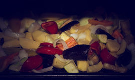 Roasted organic vegetables on a baking tray. Vegan food Royalty Free Stock Photography