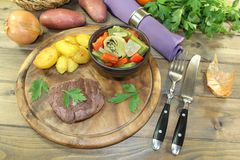 Roasted ostrich steak with baked potatoes Stock Images