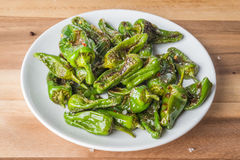 Roasted padron peppers on a plate Stock Image