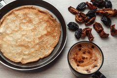 Pancake coffee and dried fruits royalty free stock image