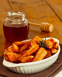 Roasted Parsnips. Roasted parsnip vegetables drizzled with honey on rustic wooden table stock photos
