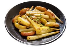 Roasted Parsnips with Apple and Thyme royalty free stock photography