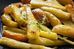 Roasted Parsnips with Apple and Thyme stock photography