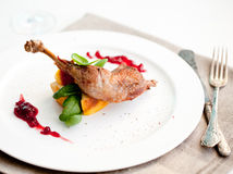 Roasted partridge, chicken thigh with salad Royalty Free Stock Image