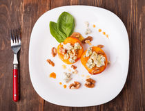 Roasted peaches with dorblu cheese Royalty Free Stock Image