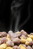 Roasted Peanuts. On black background Stock Photography