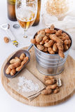 Roasted peanuts on a bowl over white background Stock Image