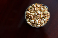 Roasted peanuts in a bowl Stock Photo