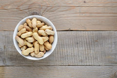 Roasted peanuts in bowl Royalty Free Stock Photo