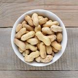 Roasted peanuts closeup in bowl Stock Photos