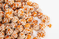 Roasted peanuts coated with sugar and sesame. Stock Photography