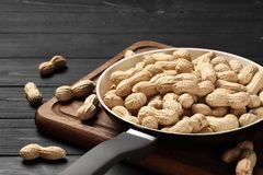 Roasted peanuts in a frying pan royalty free stock images