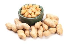 Roasted peanuts isolated on white. Roasted peanuts with peanut shells isolated on white background Stock Photography