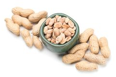 Roasted peanuts isolated on white. Roasted peanuts with peanut shells isolated on white background Royalty Free Stock Photo