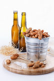 Roasted peanuts on metal bucket over white background Royalty Free Stock Photos