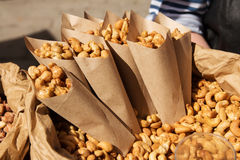 Roasted peanuts in paper envelope. Roasted cashews peanuts in paper envelope  food festival Royalty Free Stock Photos