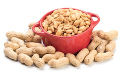 Roasted peanuts isolated on white royalty free stock images