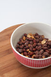 Roasted peanuts in the shell in a porcelain bowl Stock Image