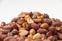 Roasted peanuts in shell on a white background Royalty Free Stock Images