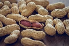 Roasted peanuts on wooden table Royalty Free Stock Image