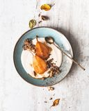 Roasted Pear with Puffed Quinoa, Walnut and Mascarpone Cream for Dessert. Healthy Food stock images