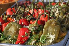Roasted peeled peppers for salad on a daylight. Red and green peeled peppers with garlic and parsley. Roasted peeled peppers for salad on a daylight. Red and Stock Images