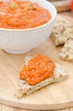 Roasted pepper dip with almonds, garlic on a piece of bread Stock Photography