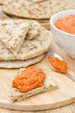 Roasted pepper dip with almonds, garlic on a piece of bread Royalty Free Stock Photos