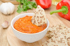 Roasted pepper dip with almonds, garlic and whole-grain bread Royalty Free Stock Images